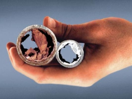 Mineral Scale build-up within the pipe of a plumbing system that GMX magnetic water conditioners can eliminate.